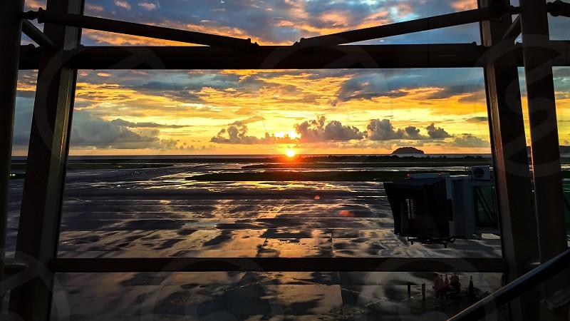 Airport sunset frame plane warm runway photo