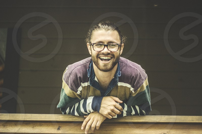 Beard glasses smile happy porch cabin hair  profile portrait photo