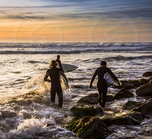 Surfers; ocean; family; pacific; California  photo