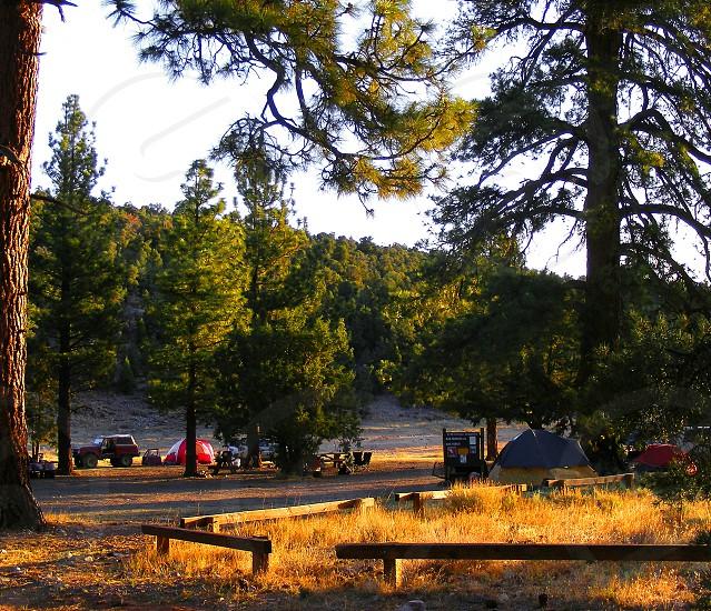 Sunrise at a mountain campsite. photo