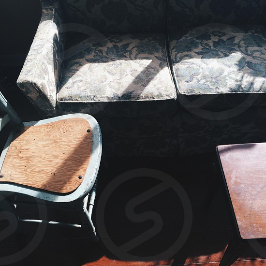 brown padded chair near couch photo