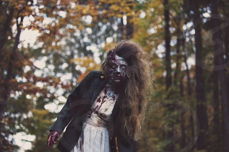 woman in zombie face painting photo