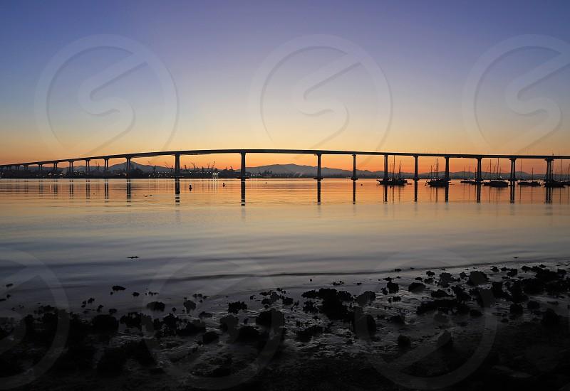 The Sunrise over the Coronado Bridge in San Diego California. photo
