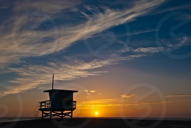 Sunset in world famous Venice Beach California. photo