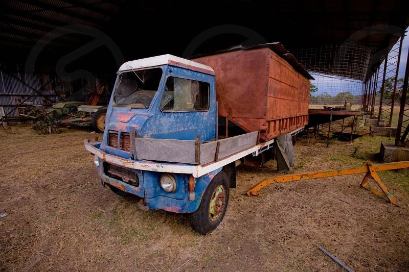 Old farm truck in a barn photo