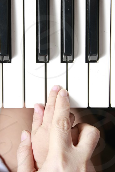 hands finger hold holding guide guiding guidance teach teacher teaching parent adult kid child small student pupil knowledge wisdom education music musician musical instrument notes octave piano organ keys keyboard school photo