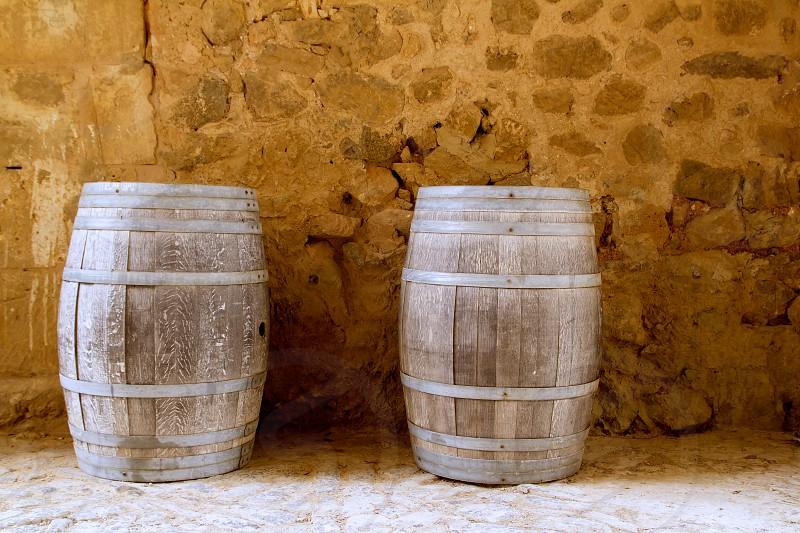 barrels of wine built in oak wood from Spain on stone masonry wall photo