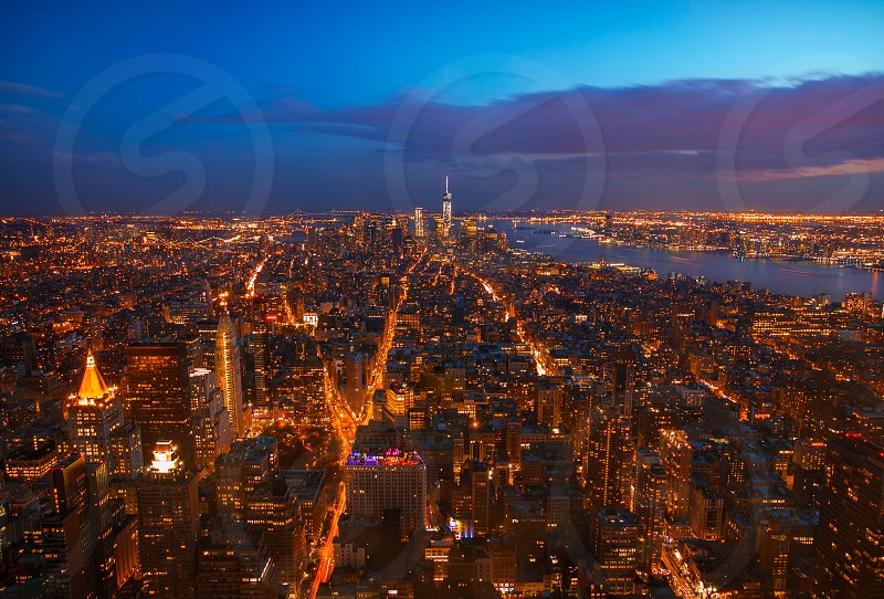 New York New York! It is my 2nd shot of cityscape in blue hour. This time I am shooting from a lot higher (86th floor). Looking over the entire cityall the light trails are just like the blood running through its veins I can almost feel the pulse of Manhattan. New York never ceases to surprise me I'm Lovin' It! photo