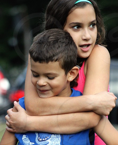 girl hugging boy photo