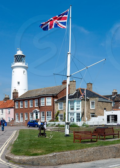 SOUTHWOLD SUFFOLK/UK - JUNE 2 : Union jack flag flying near the lighthouse in Southwold Suffolk on June 2 2010. Unidentified people. photo