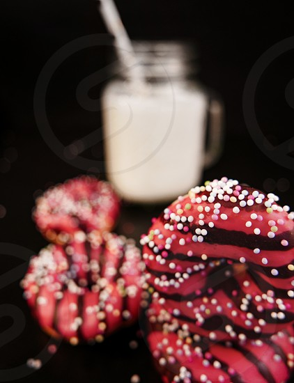 Pink donuts on black background. photo