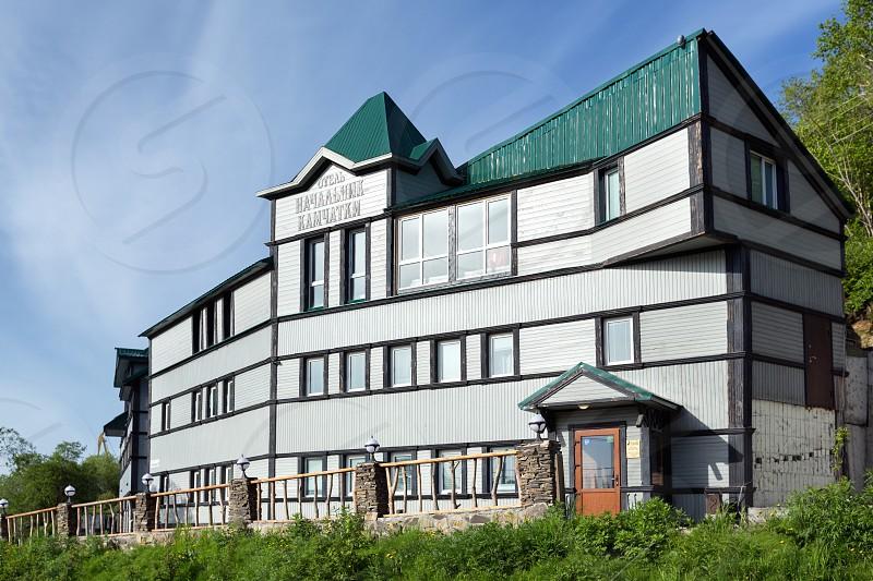 PETROPAVLOVSK-KAMCHATSKY CITY KAMCHATKA PENINSULA RUSSIAN FAR EAST - JUNE 16 2017: Summer view of facade building of Hotel Chief of Kamchatka (Nachalnik Kamchatki) in Petropavlovsk-Kamchatsky City. photo