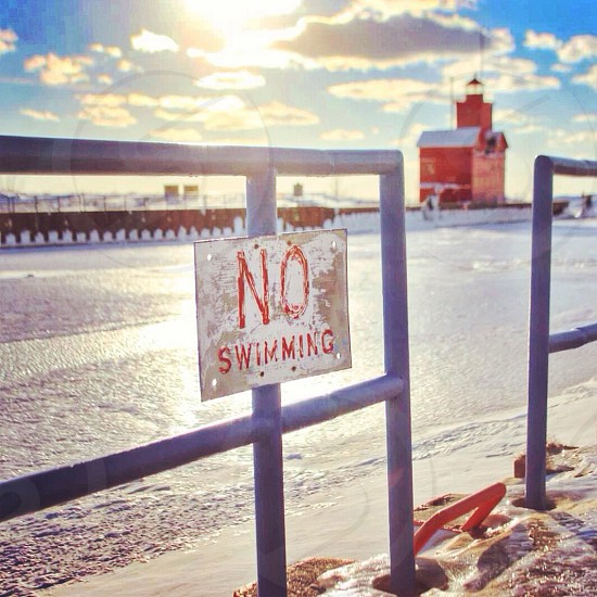 No Swimming signage selective focus photograph photo