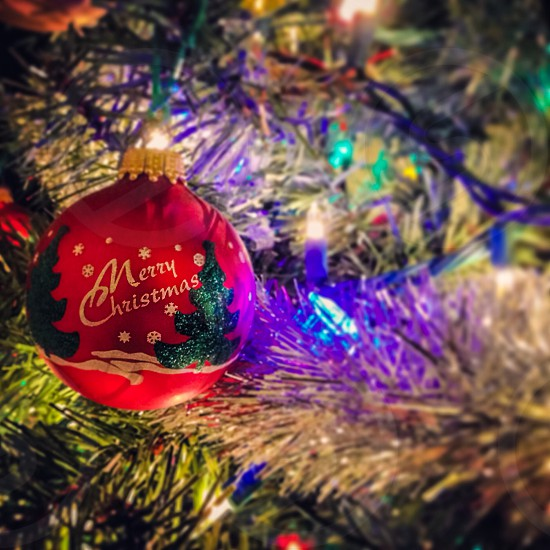 red merry christmas ornamental ball photo