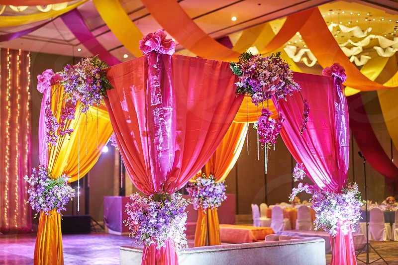 The colorful stage decoration with bright shade of color for bride and groom in the sangeet night of traditional indian wedding photo
