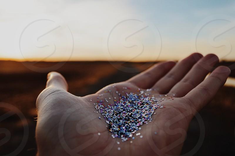 glitters in human palm photo