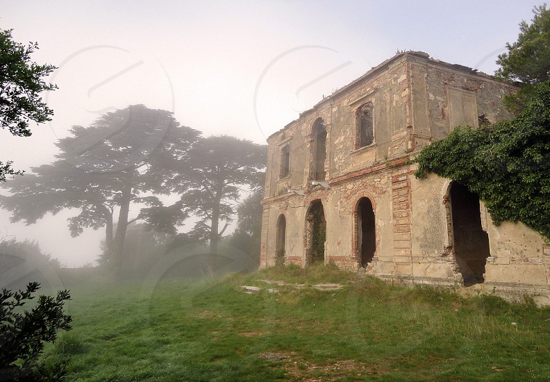 Ruins of an ancient villa in the fog photo