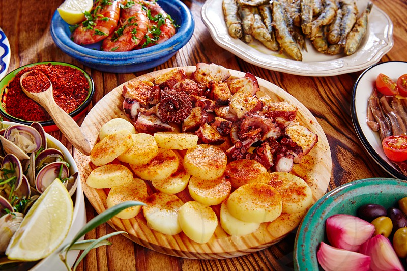 Tapas Pulpo a Feira with octopus potatoes gallega style and paprika recipe from Spain photo