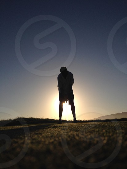 Peaceful green putting into the sunset on the Pacific Coast; golf sunset peaceful inspiring reflective meditative photo