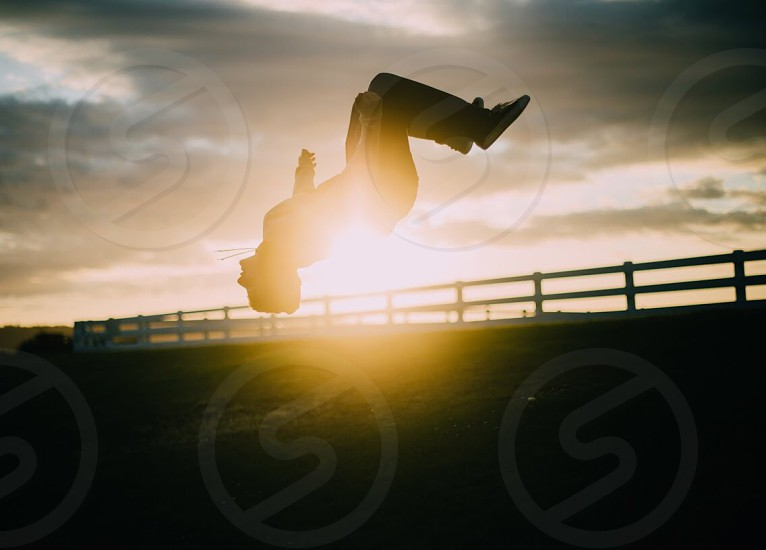 Why watch the sunset when you can backflip over it? photo