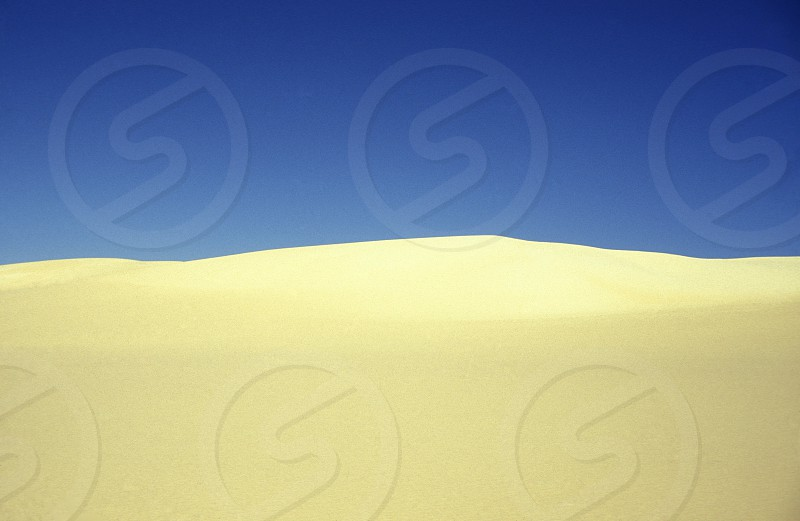 the sanddunes near the Oasis and village of Siwa in the lybian or western desert of Egypt in north africa photo