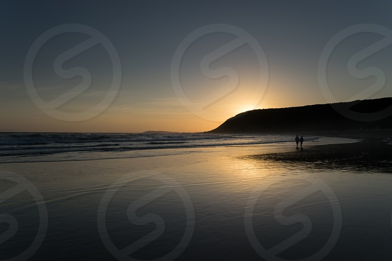 reflection sunset beach ocean mountain sky twilight water waves ocean south africa photo