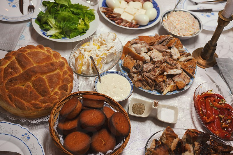 A lot of celebrity food on the table a celebration called Slava in Serbia. photo