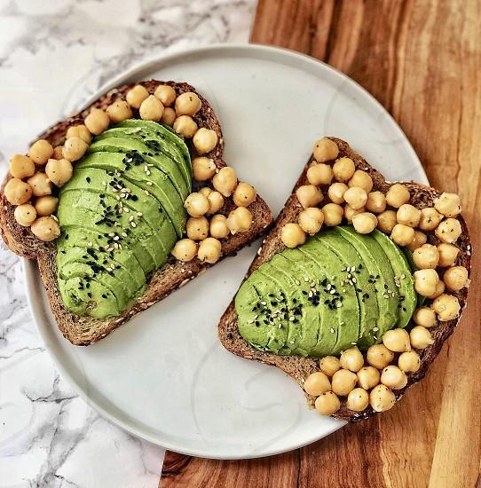 Chickpea and avocado toast with black sesame seeds photo