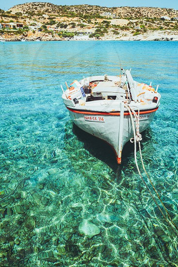 Boat sea transparency  water floating bottom silent lifestyle  boating lifestyle  sailing photo