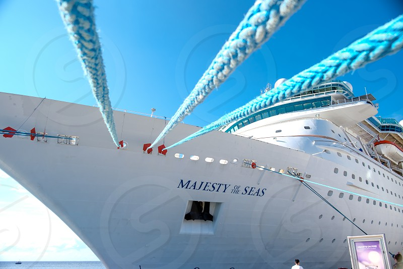 View of cruise ships bow underneath the ropes holing ship to dock. photo