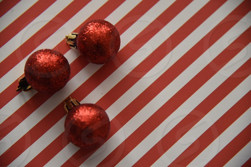 Holidays wrapping ornaments red stripes festive Christmas glitter gifts presents photo