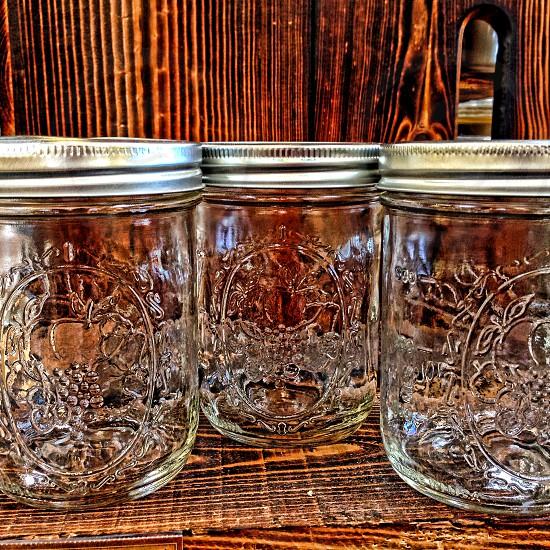 Three decorative mason jars. photo