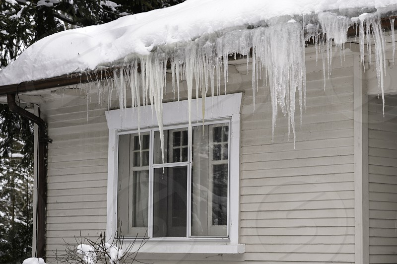 Icicles hanging from house in Winter photo