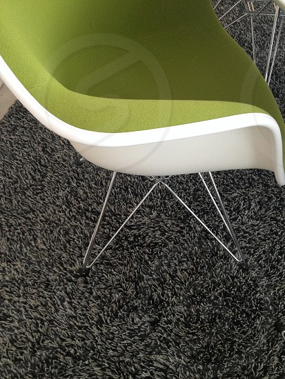 white chair with a green cushion photo