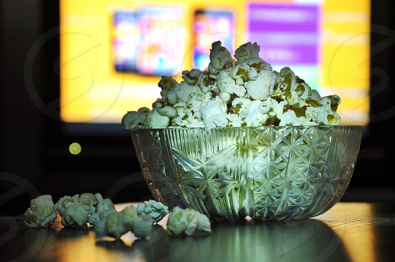 popcorns in clear glass bowl photo