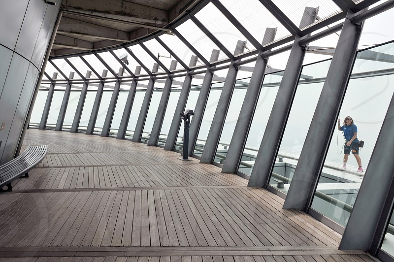 Interior of Macau Tower at the observation deck at the height of 233 meters accessible to Skywalk and Skyjump area outside the tower photo