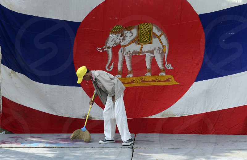 a men cleans a podium with a Thai Flag in Banglangphu in the city of Bangkok in Thailand in Southeastasia. photo