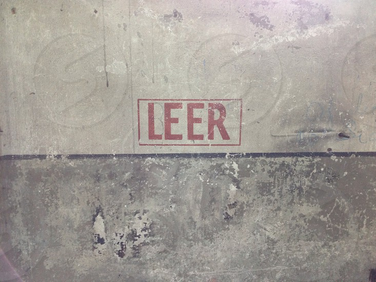 """Wall of a guard building in a Nazi concentration camp. The word is translated """"empty."""" photo"""
