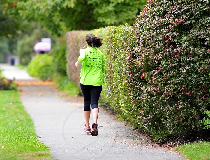 Female Jogging on Sidewalk photo