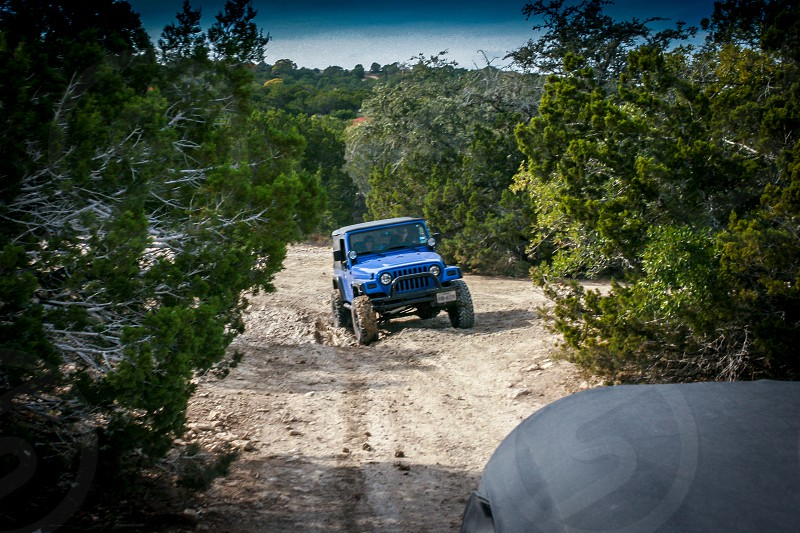 jeep dirt trail wild grit gritty dirt mud rugged perspective blue photo