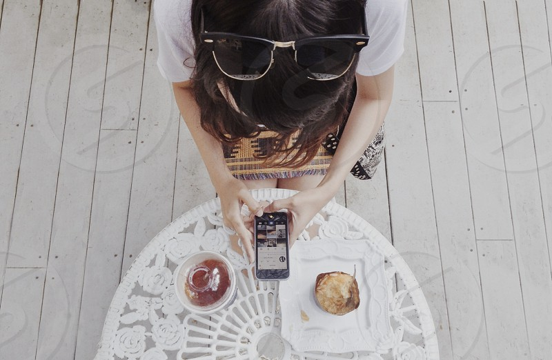 woman playing her smartphone photo