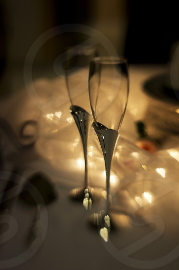 Toasting flutes with heart bokeh photo
