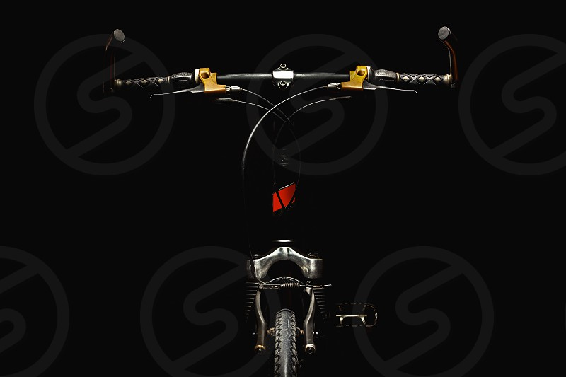 Part of a modern sport bicycle accentuated shapes with illumination.  photo