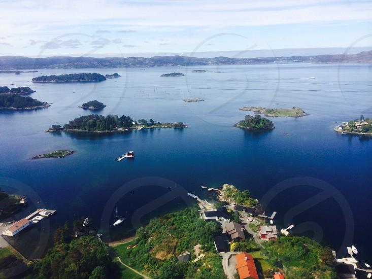 green islands under blue sky during daytime photo