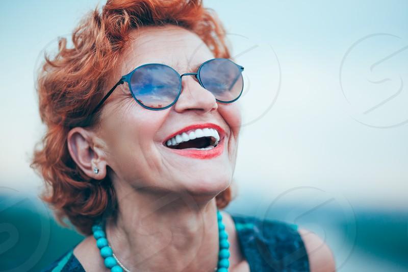 Happy mature woman enjoying life photo