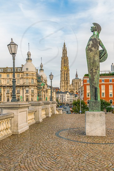 Cathedral of Our Lady and Godin Minerva Statue. Antwerpen. Belgium photo