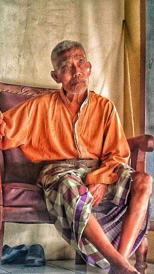 Old Man..Time keeps running Age is growing Human is not eternal Only his kindness is eternal photo