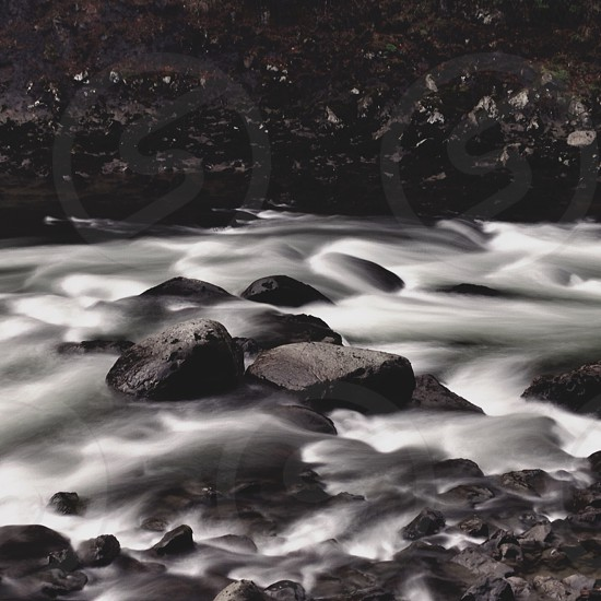 gray rocks on the river photo