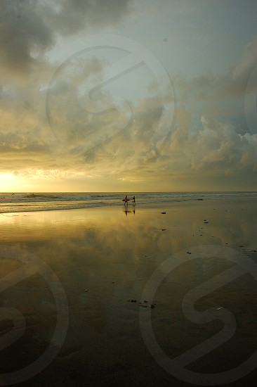 enjoy sunset on the beach in Bali photo