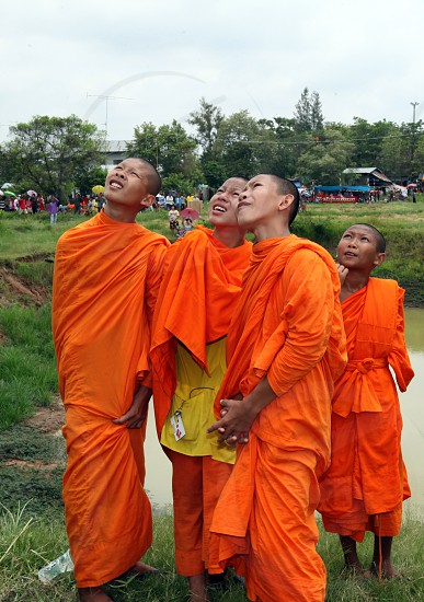 monks at the Bun Bang Fai Festival or Rocket Festival in the City of Yasothon in the Region of Isan in Northeast Thailand in Thailand.
